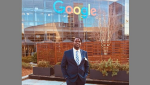 Andrew Kirima in front of a Google building