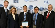 The UA team and IISE officials pose at the institute's annual conference in May 2018. From left: IISE immediate past president Joseph Hartman, IISE president-elect and CFO Jamie Rogers, Seunghan Lee, Young-Jun Son, and IISE president Tim McGlothlin.