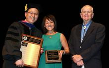 2017 Alumni of the Year awardee Cindy Klingberg is flanked by Young-Jun Son, left, head of the Department of Systems and Industrial Engineering, and Herb Burton, last year's inaugural recipient, at a precommencement program in May.