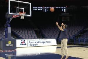 Ricardo Valerdi makes a free throw shot while promoting his new course, Sports Analytics