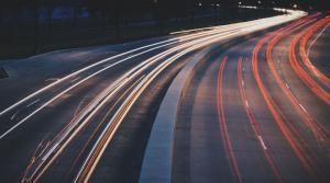 Timelapse photo of a highway, showing headlights and taillights